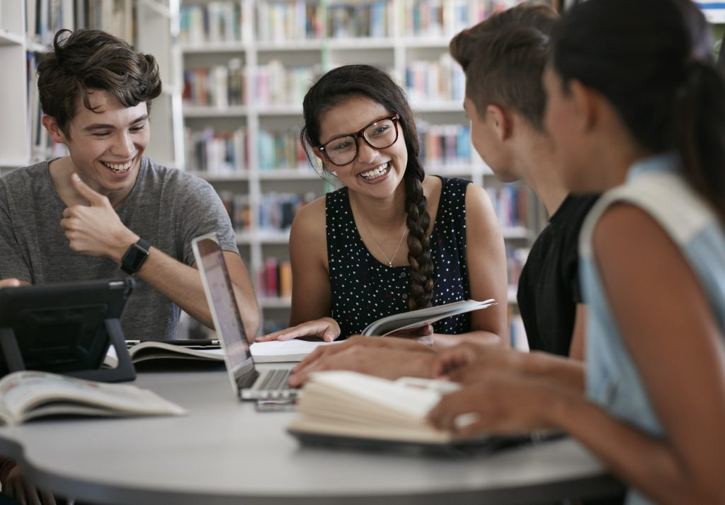 Smiling diverse teens working in a group